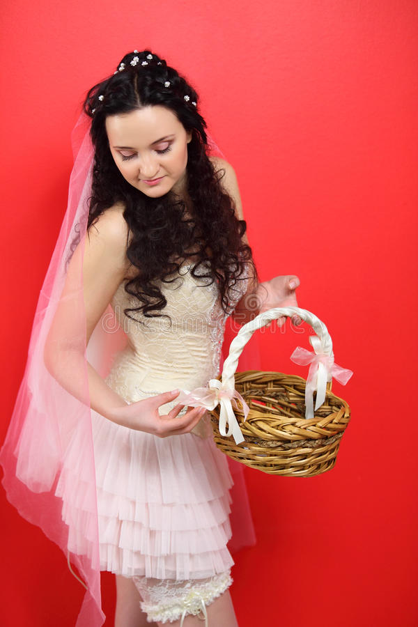 Bride Wearing In White Short Dress Holds Basket Royalty Free Stock Photo
