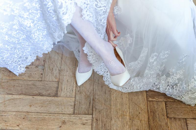 The bride wears shoes stock photo