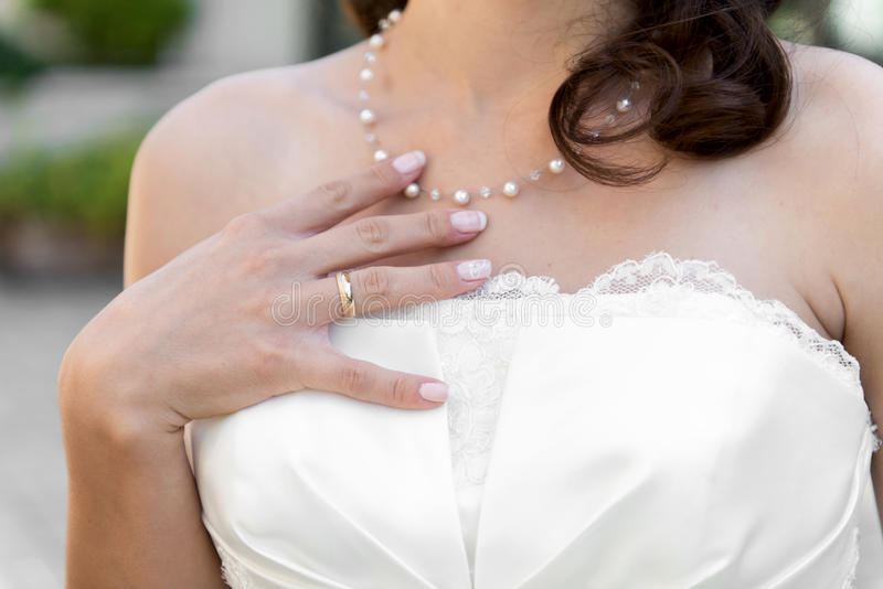 Bride with a wedding bouqet - selective focus. Bride with a wedding bouqet royalty free stock photo
