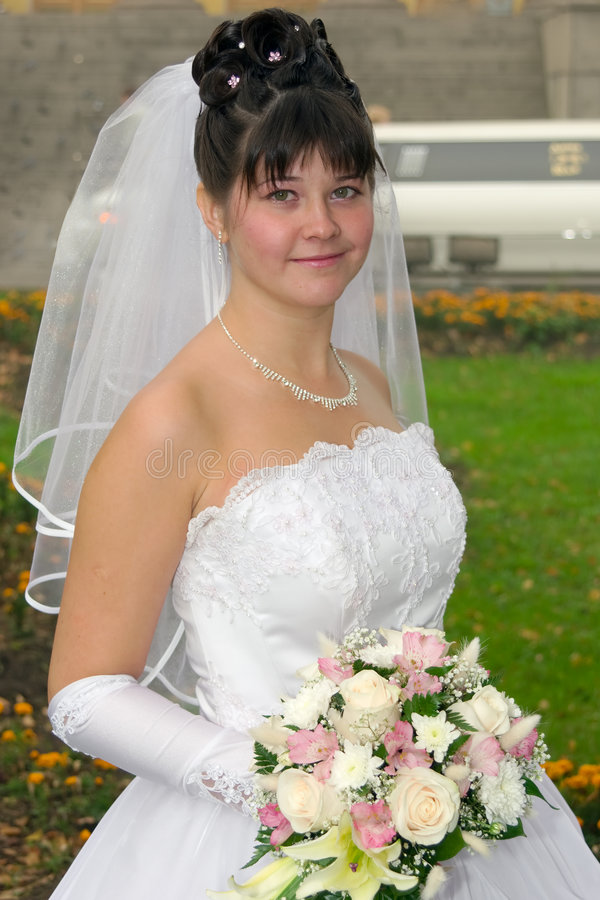 Bride with wedding bouquet. Young beautiful bride with wedding bouquet royalty free stock photography