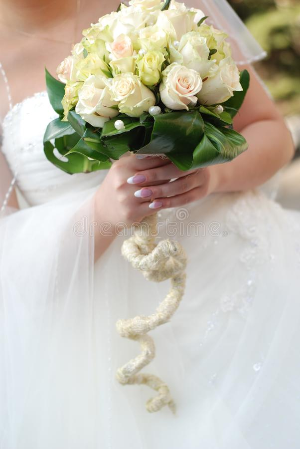 Bride and wedding bouquet royalty free stock photo
