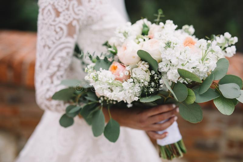 bride with wedding bouquet from orange and wite roses royalty free stock photo