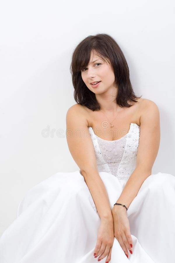 Bride in a wedding dress royalty free stock images