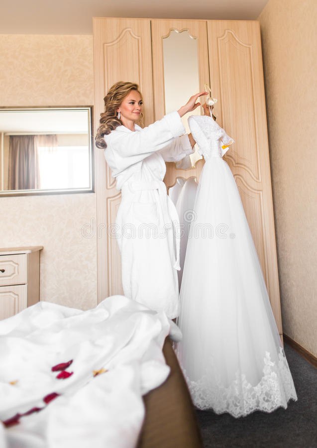 Download The Bride In White Bathrobe Wedding Preparations Stock Photo