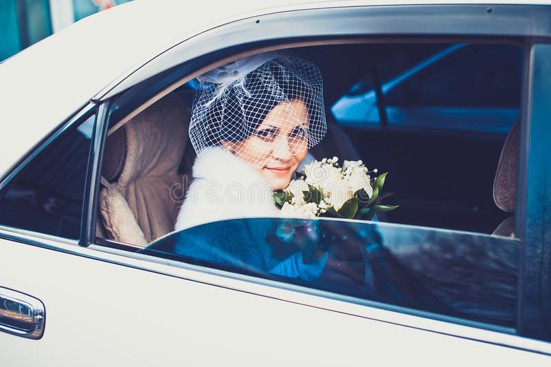 Bride in white car royalty free stock photos