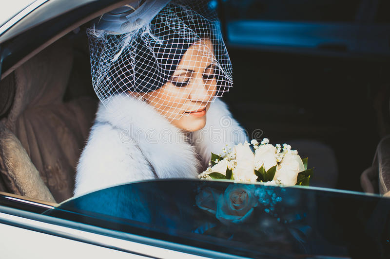 Bride in white car stock image
