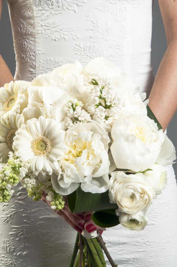 Bride in white dress with bridal bouquet stock photos