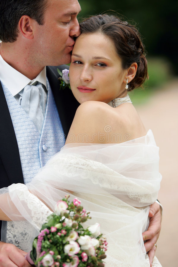 Bride in white dress with groom royalty free stock photos