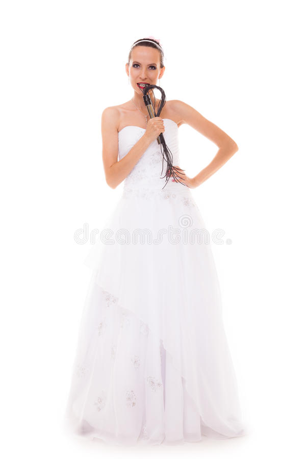 Bride white gown holds black leather flogging whip royalty free stock images