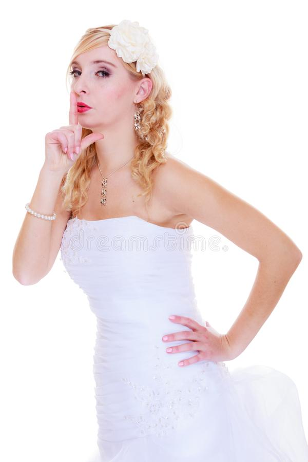 Bride in white wedding dress showing silence sign stock images