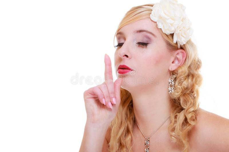 Bride in white wedding dress showing silence sign stock photos