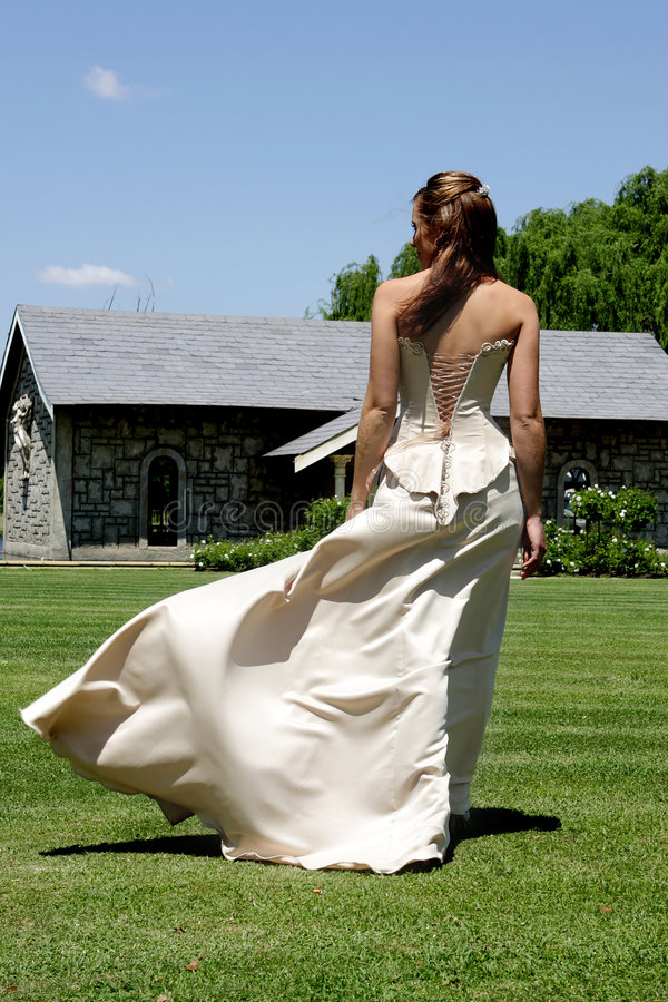Bride Wind. A bride walking outside and wind blowing her dress stock photography