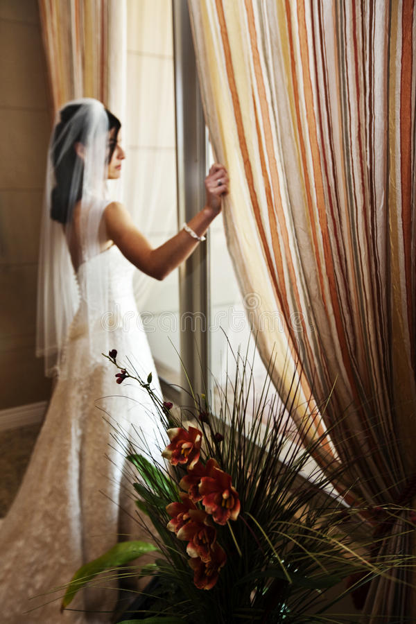 Bride at window stock photo