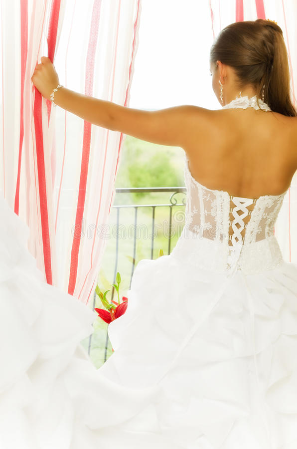 Bride at window stock images