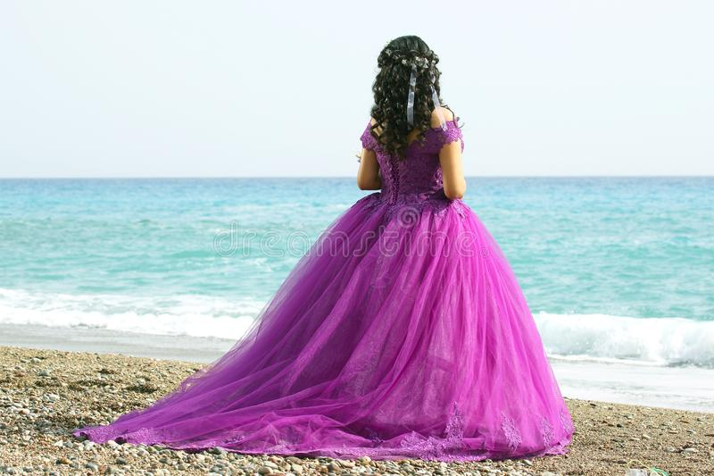 Bride woman in elegant dress on the beach. The bride woman in elegant dress on the beach royalty free stock image