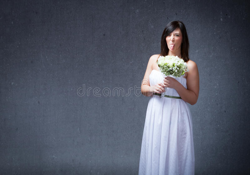 Bride woman made faces. People emotions and expressions in dark background stock image