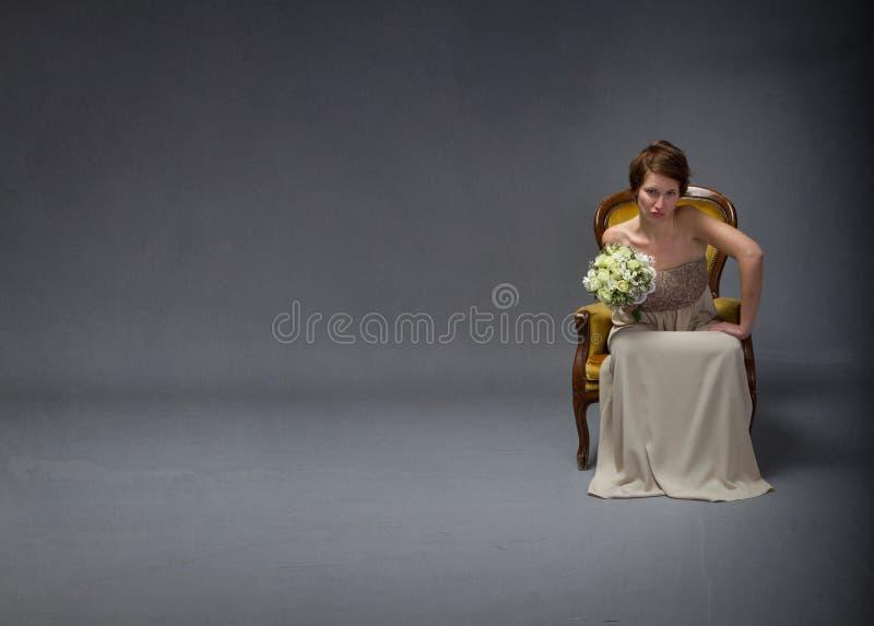 Bride woman unhappy in solitude mode. Dark background stock photography