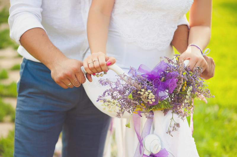 Bridegroom and bride holding wedding bridal bouquet royalty free stock photo