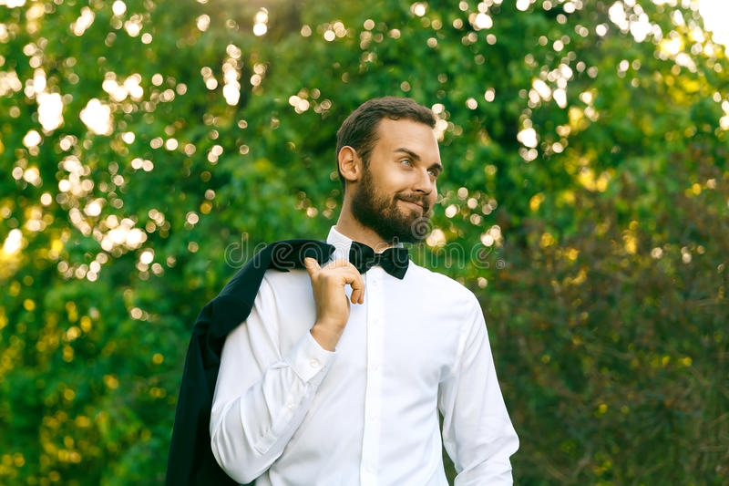 Bridegroom in a park royalty free stock photo