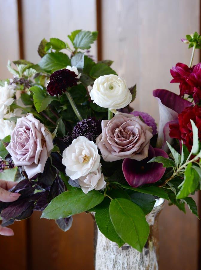 Brides bouquet in cool mauve tones close up stock images
