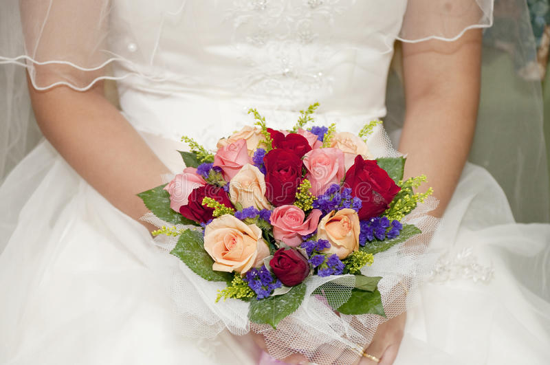 Brides bouquet roses. A brides wedding bouquet of roses royalty free stock photography