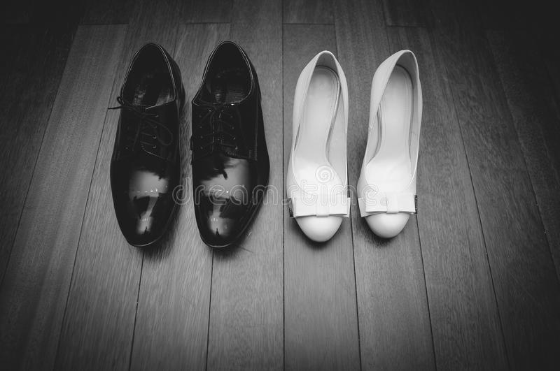 Brides and grooms shoes stock image