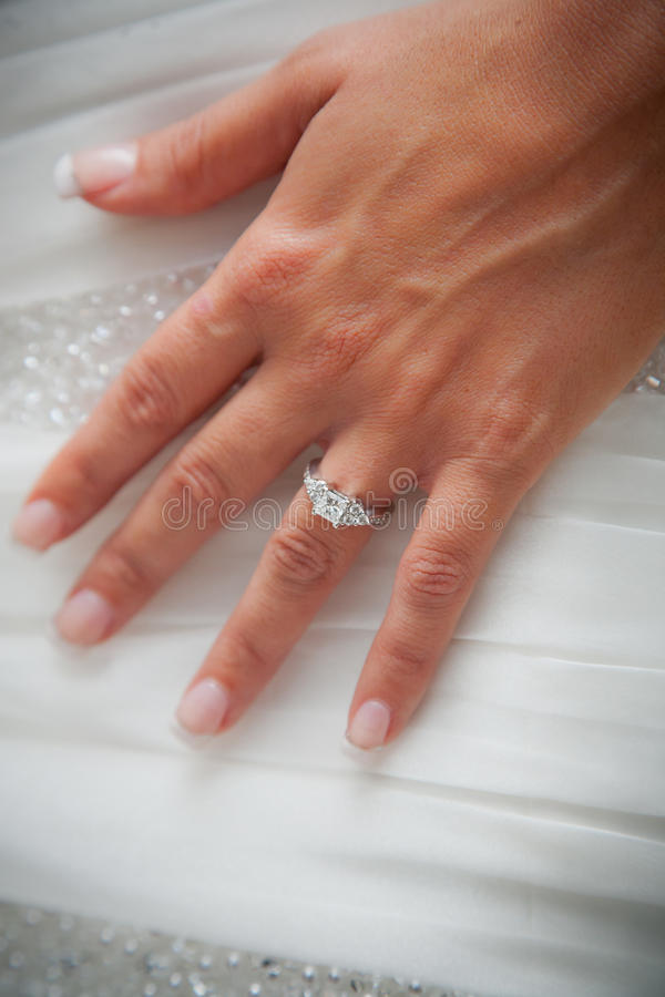 Brides hand with engagement ring royalty free stock photos