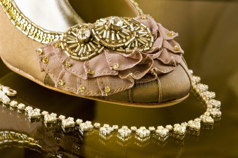 Brides Wedding Shoe and Necklace. Description: Bride's Wedding Shoe and Necklace Arrangement (Macro royalty free stock images