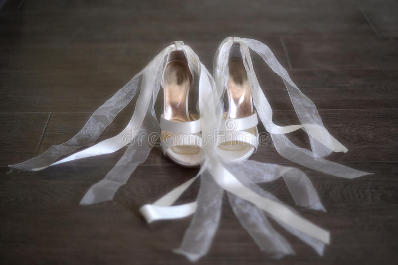 Brides white wedding shoes royalty free stock photography