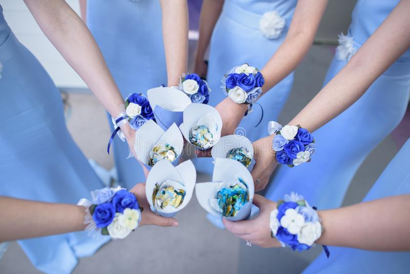 Bridesmaid with flowers wrist corsage stock photography
