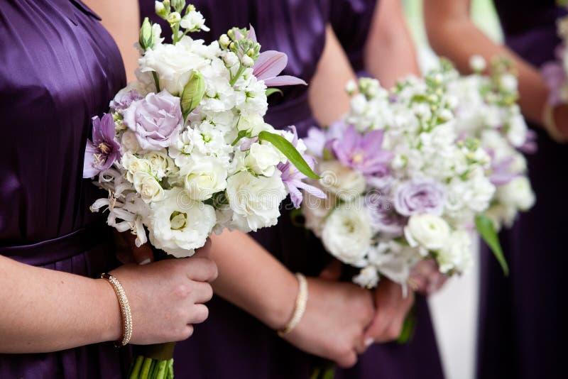 Bridesmaid holding bouquet stock photos