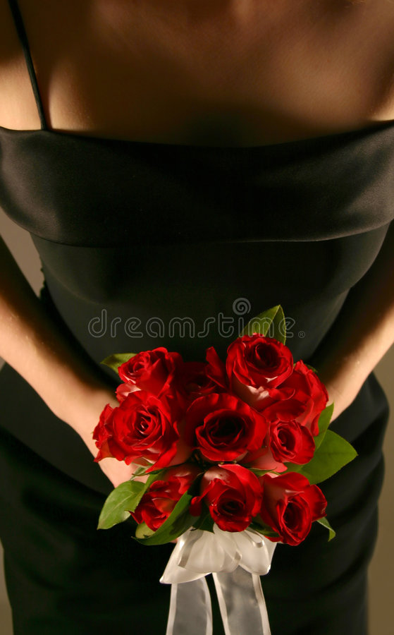 Download Bridesmaid Holding Roses stock photo. Image of black, bouquet - 101616