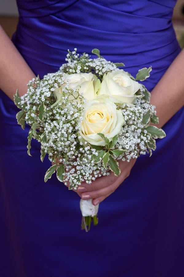 Bridesmaid holding a wedding bouquet royalty free stock photos