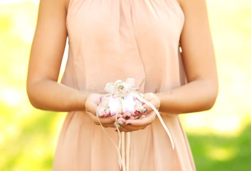 Bridesmaid holding wedding rings royalty free stock photography