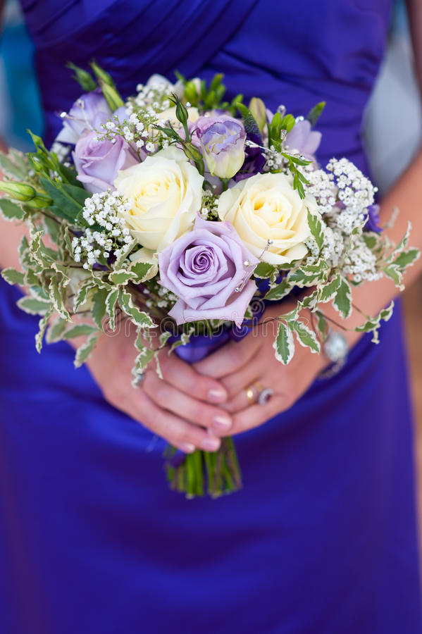 Bridesmaid holds a wedding bouquet stock images