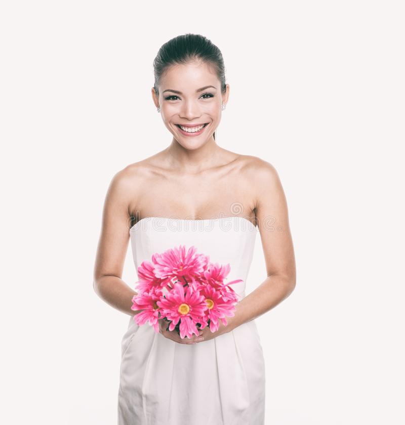 Bridesmaid wedding dress girl with flower bouquet. Asian woman beauty in studio. Maid of honor or bride getting married royalty free stock photo