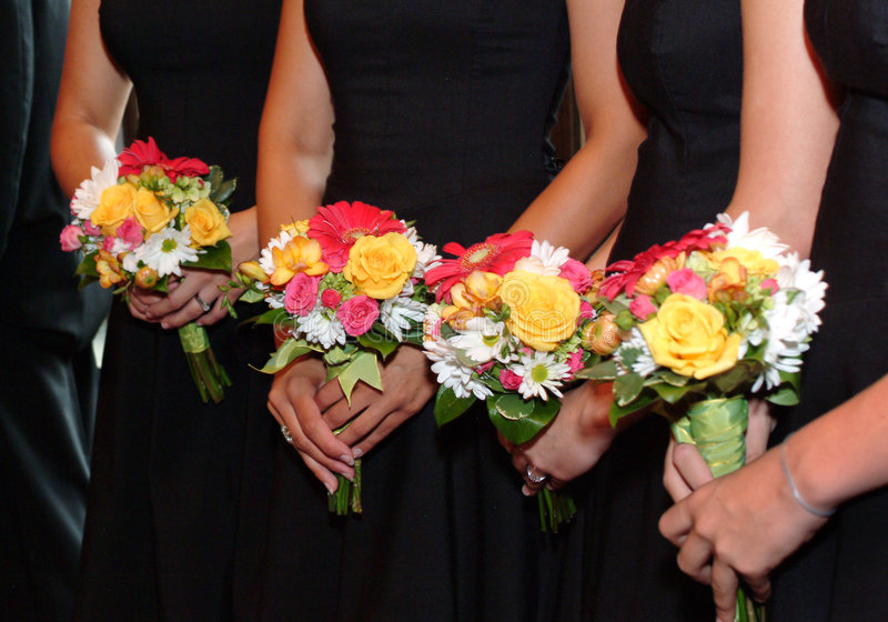 Bridesmaids and bouquets royalty free stock photo