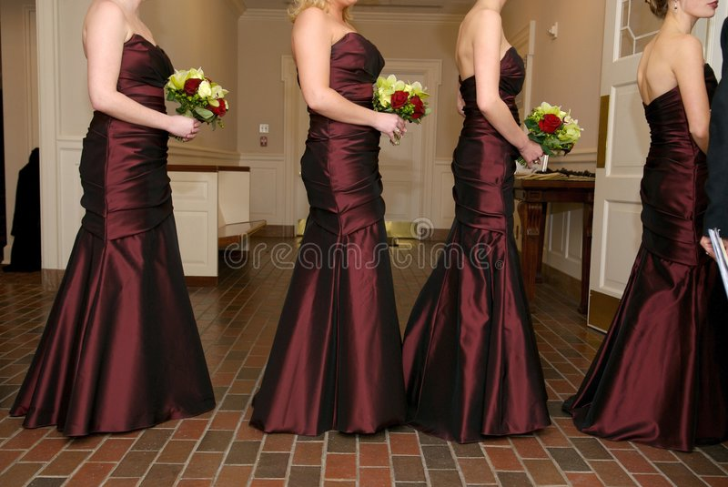 Bridesmaids holding their wedding bouquets stock images