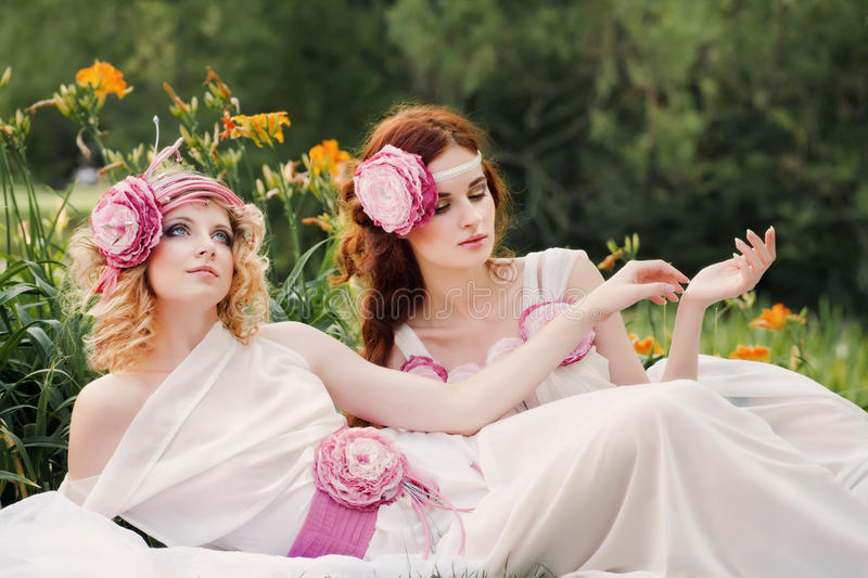 Bridesmaids rest on nature. royalty free stock images
