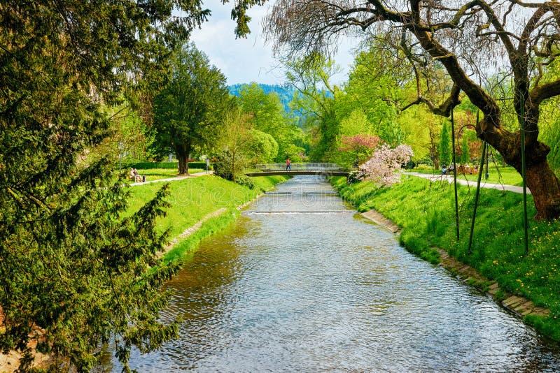 Bridge above river at Gonneranlage Kurpark in Baden Baden Germany stock photography
