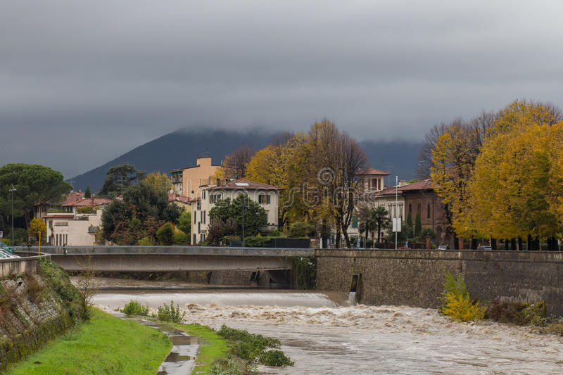 Bridge across of Bisenzio River and river shore. Prato. Tuscany. Italy. stock image
