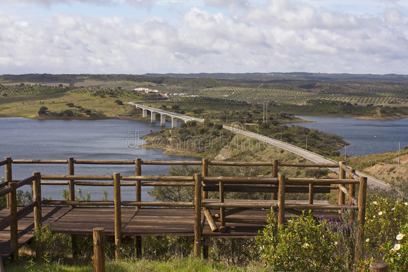 Bridge in the Alqueva lake. Beautiful view over the bridge into the lake of Alqueva in Alentejo, Portugal royalty free stock images