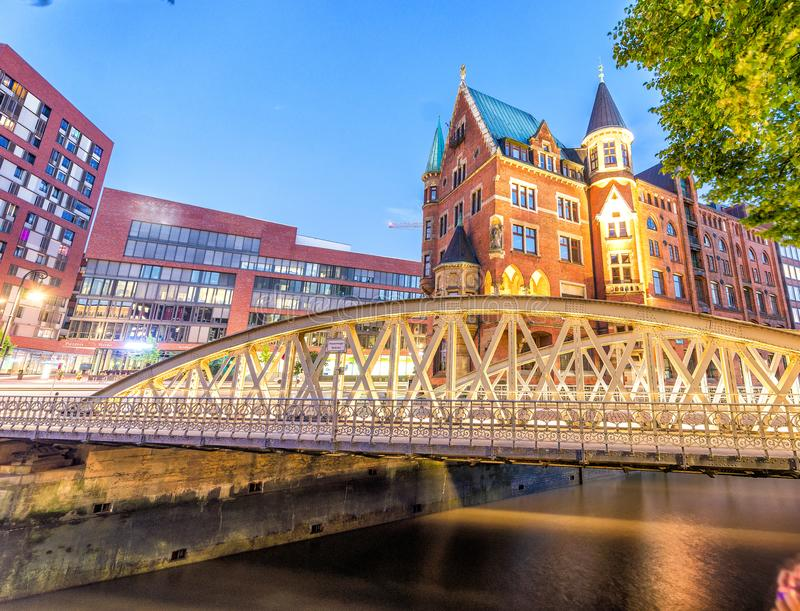 Bridge and ancient buildings of Hamburg at night, Germany stock images