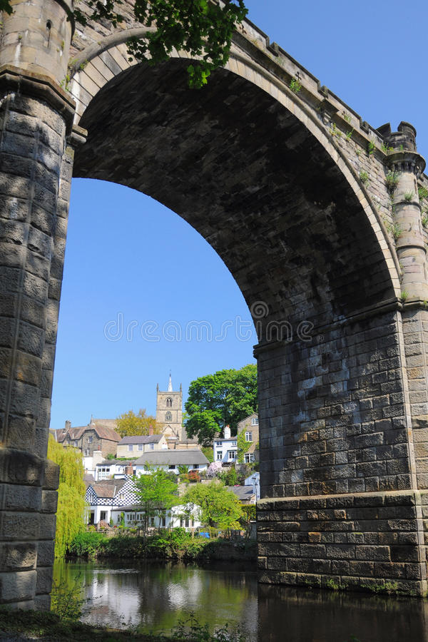 Bridge arch and castle in Knaresborough, Yorkshire. Caste and village framed by the arch of old viaduct bridge in Knaresborough, taken in bright summer sunlight royalty free stock image