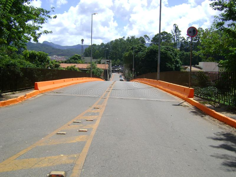 Bridge in Barrão de Cocais. Bridge under the river São João, The orange painting lateral, indicates the mud of the mining company Vale that will flood royalty free stock photo