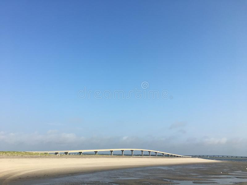 Bridge at the beach with big blue sky. In New Jersey with ocean and sand in summer stock photo