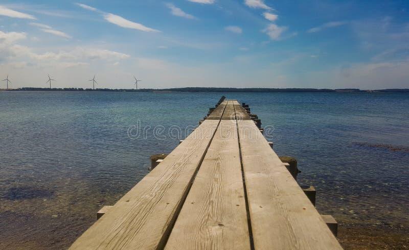 Bridge at beach stock images