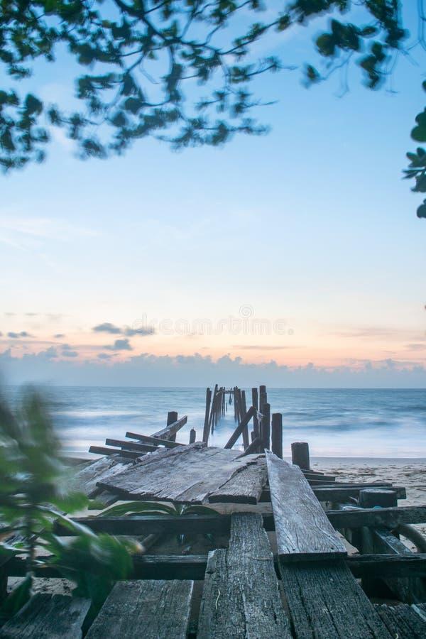 Bridge on beach at sunset time Long exposure. Old bridge on beach at sunset time Long exposure royalty free stock photo