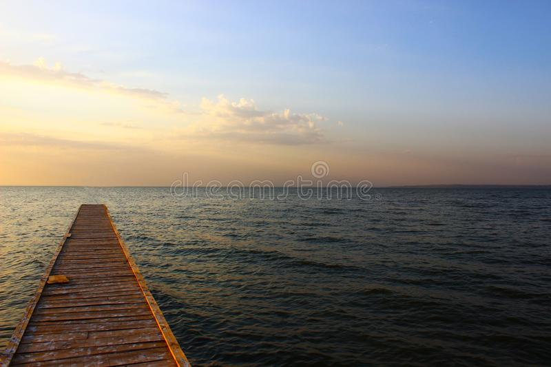 Bridge by the black sea in sunset stock photography
