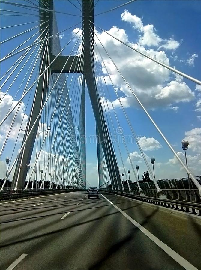Bridge blue sky car clouds royalty free stock photography